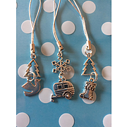 Caravan Christmas decorations with christmas trees, snowflakes, stocking and dove charms