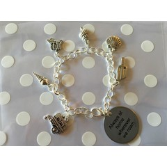 Beautiful ^^^Always at home wherever we roam^^^ charm bracelet decorated with shells, caravan, lollies, sand castle, and ice cream charms perfect gift